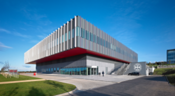 The CRM building is a distinctive grey and red